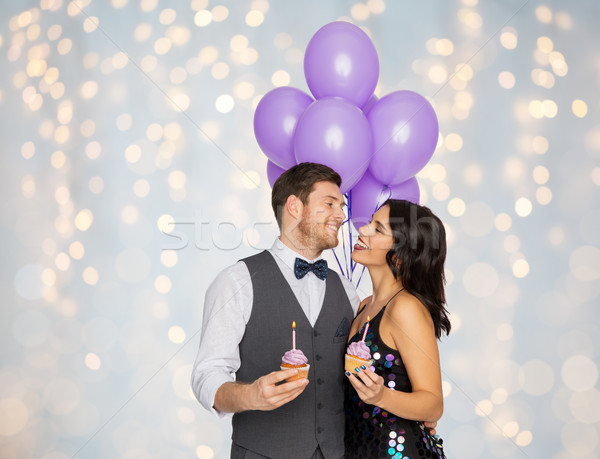 happy couple with balloons and cupcakes at party Stock photo © dolgachov