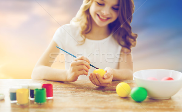 close up of girl coloring easter eggs Stock photo © dolgachov