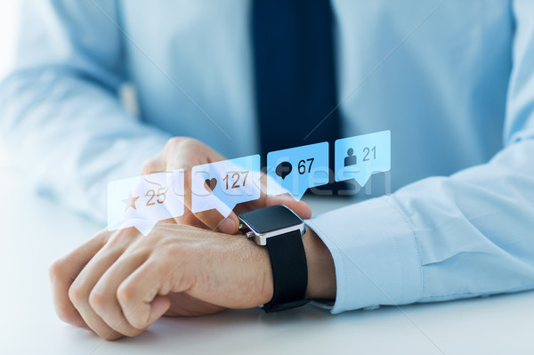 hands with smart watch and social media icons Stock photo © dolgachov