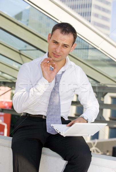 обсуждение фотография красивый бизнесмен белый портативного компьютера Сток-фото © dolgachov