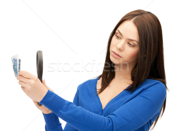 woman with magnifying glass and euro cash money Stock photo © dolgachov