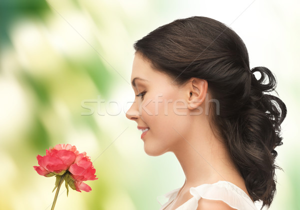 Stock photo: young and beautiful woman with flower