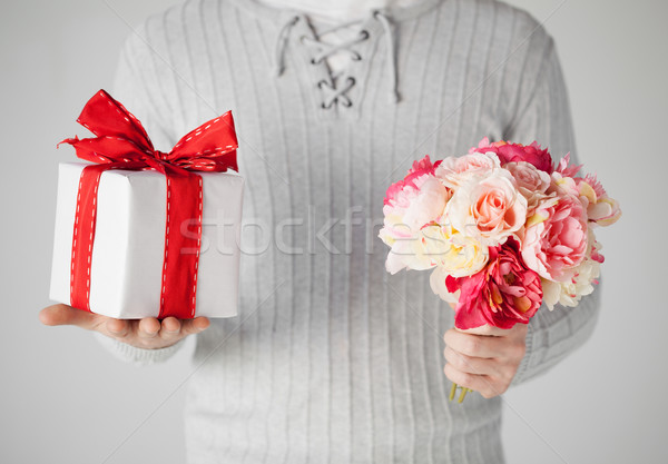 man holding bouquet of flowers and gift box Stock photo © dolgachov