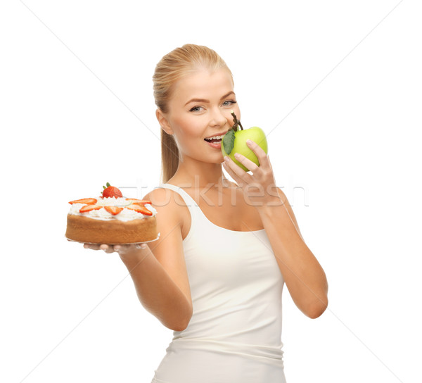 woman eating apple and holding cake Stock photo © dolgachov