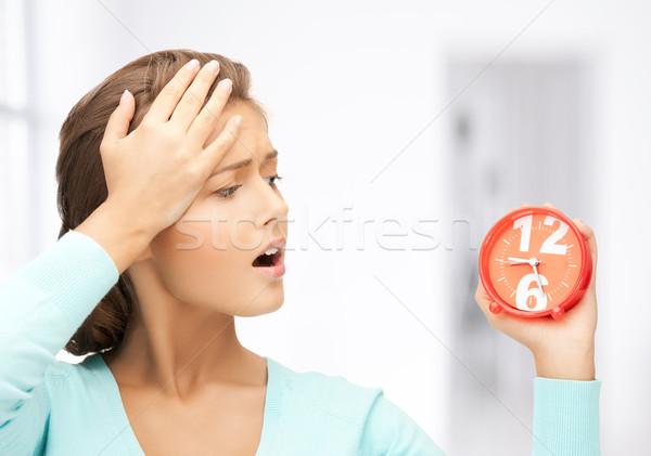 woman with alarm clock Stock photo © dolgachov