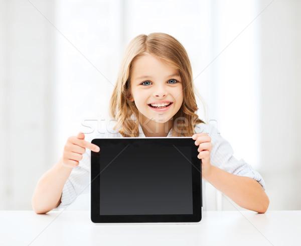 girl with tablet pc at school Stock photo © dolgachov