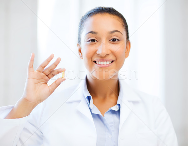 Stock photo: african doctor one omega pill