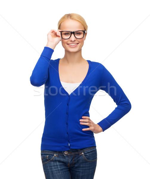 Сток-фото: улыбающаяся · женщина · случайный · одежды · очки · видение