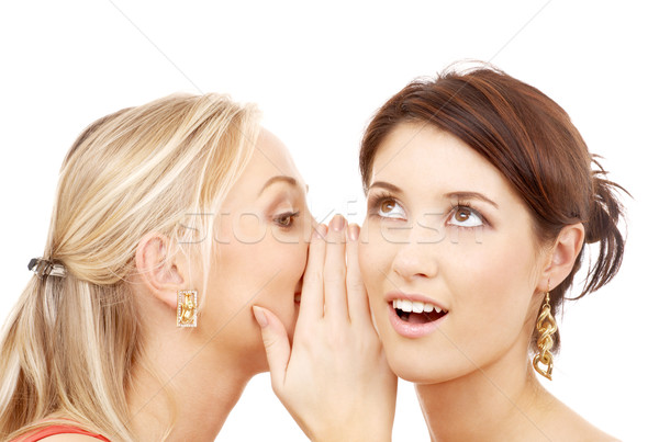 two smiling women whispering gossip Stock photo © dolgachov