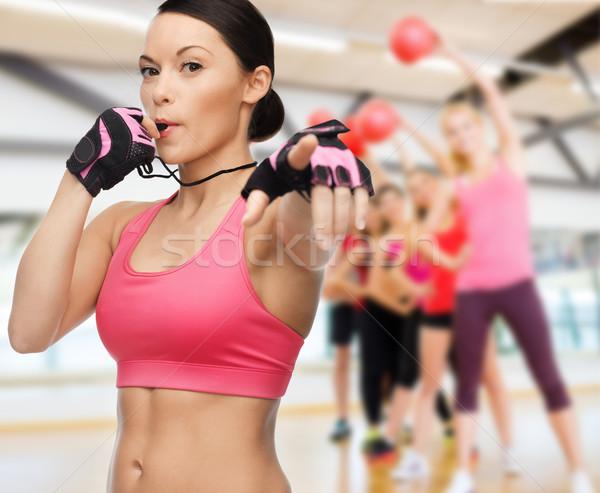woman with whistle in gym Stock photo © dolgachov
