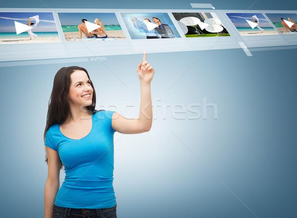 smiling teenager pointing her finger videos Stock photo © dolgachov
