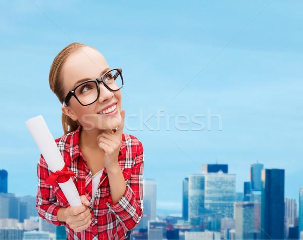 smiling woman in black eyeglasses with diploma Stock photo © dolgachov
