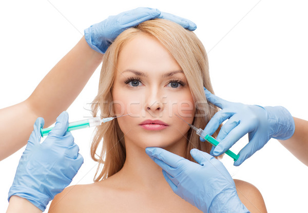 woman face and beautician hands with syringes Stock photo © dolgachov