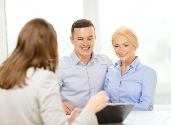 smiling couple at bank Stock photo © dolgachov