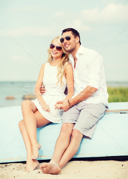 couple in shades at sea side Stock photo © dolgachov