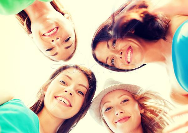 Facce ragazze guardando verso il basso sorridere estate vacanze Foto d'archivio © dolgachov