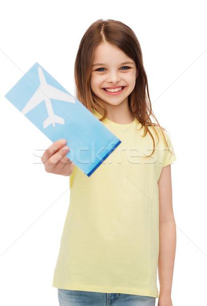 Sorridente little girl avião bilhete viajar férias Foto stock © dolgachov