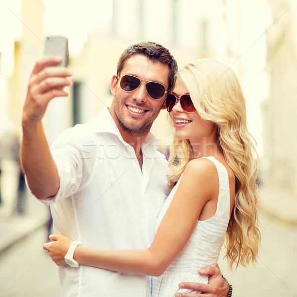 Stockfoto: Glimlachend · paar · smartphone · zomer · vakantie