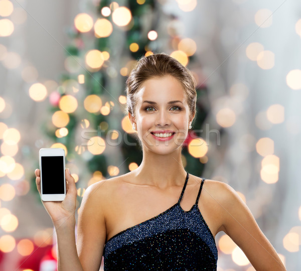 4758477_stock-photo-smiling-woman-in-evening-dress-with-smartphone.jpg