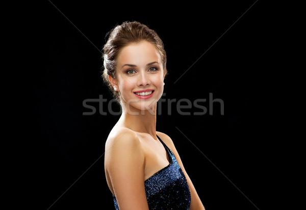 Mosolygó nő estélyi ruha emberek ünnepek báj fekete Stock fotó © dolgachov