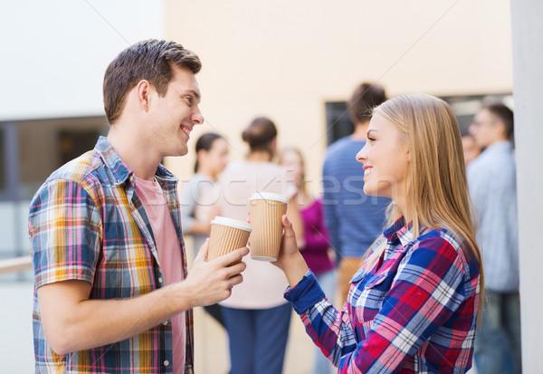 Grupo sonriendo estudiantes papel las tazas de café amistad Foto stock © dolgachov