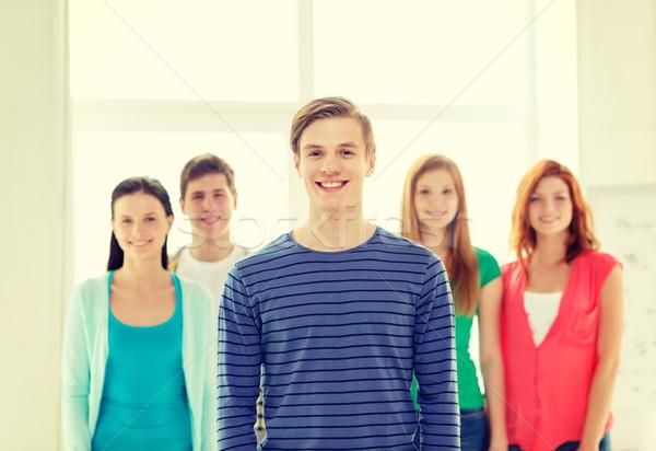 Mosolyog diákok tizenéves fiú elöl oktatás iskola Stock fotó © dolgachov