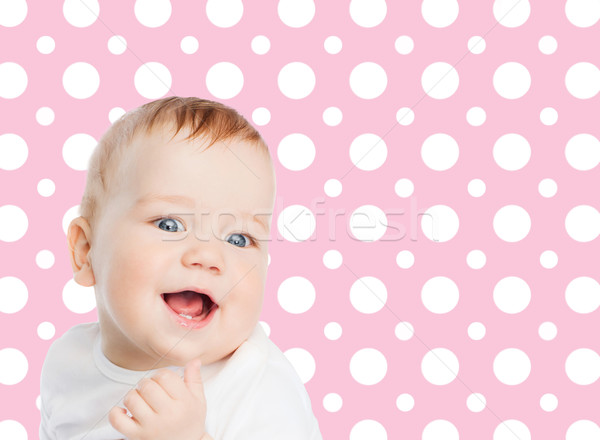 smiling baby girl face over pink polka dots Stock photo © dolgachov