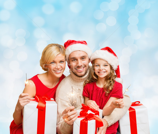 happy family in santa helper hats with gift boxes Stock photo © dolgachov