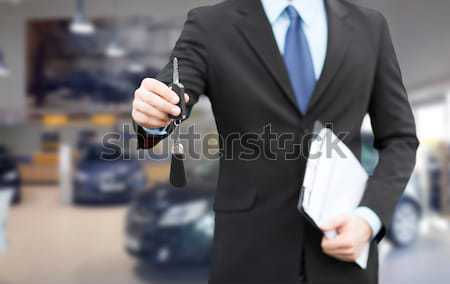 close up of businessman or salesman giving car key Stock photo © dolgachov