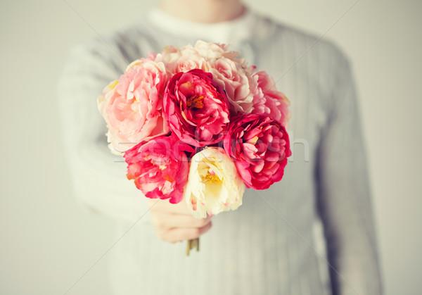 man giving bouquet of flowers Stock photo © dolgachov