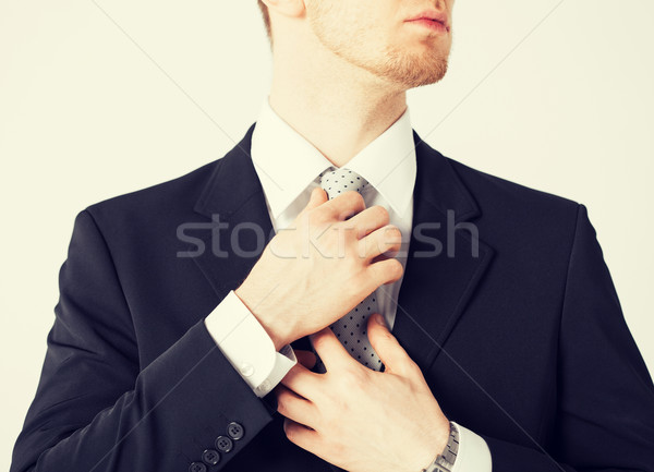 man adjusting his tie Stock photo © dolgachov