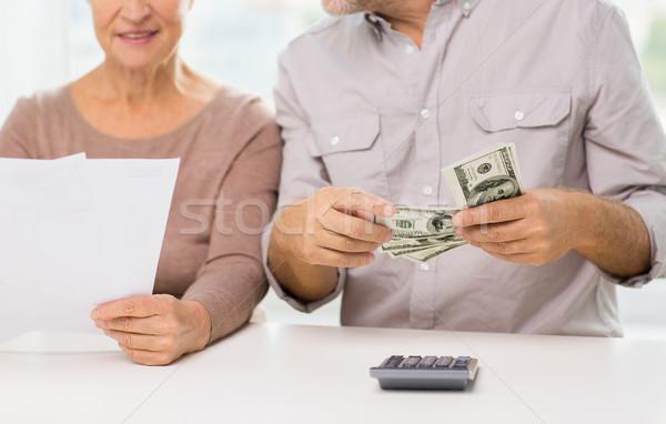 close up of senior couple with money and bills Stock photo © dolgachov