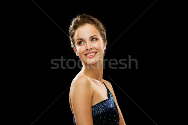 beautiful woman wearing pearl earrings Stock photo © dolgachov