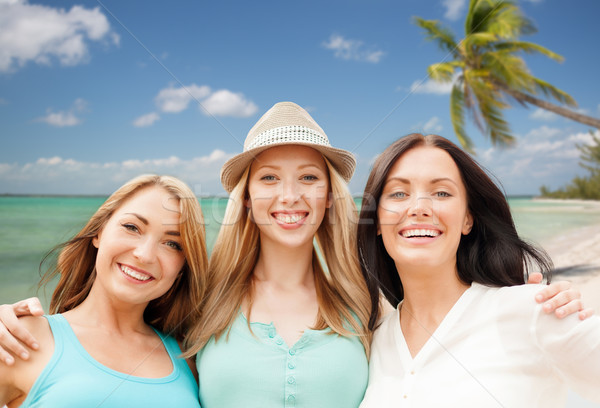 group of happy young women over summer beach Stock photo © dolgachov