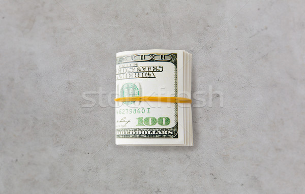 close uop of dollar money packet tied with rubber Stock photo © dolgachov