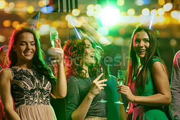 happy friends with glasses of champagne in club Stock photo © dolgachov