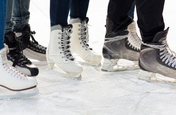 close up of legs in skates on skating rink Stock photo © dolgachov