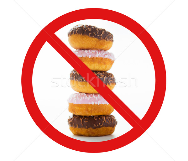 close up of glazed donuts pile behind no symbol Stock photo © dolgachov