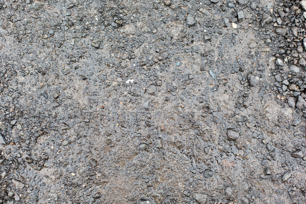 Stock photo: close up of wet gray gravel road or ground