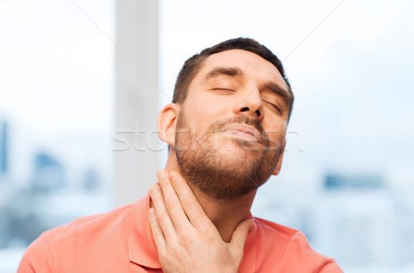 Infeliz homem sofrimento garganta dor casa Foto stock © dolgachov