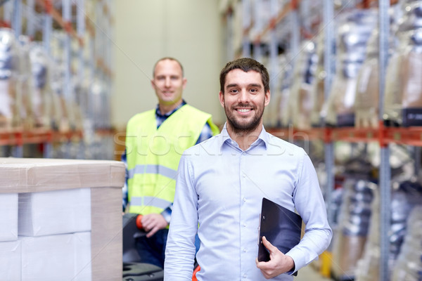 businessman with clipboard  over warehouse loader Stock photo © dolgachov