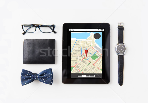 tablet pc with navigator map and personal stuff Stock photo © dolgachov