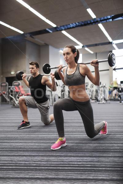 молодым человеком женщину подготовки штанга спортзал спорт Сток-фото © dolgachov