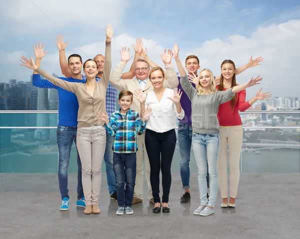 group of smiling people waving hands Stock photo © dolgachov