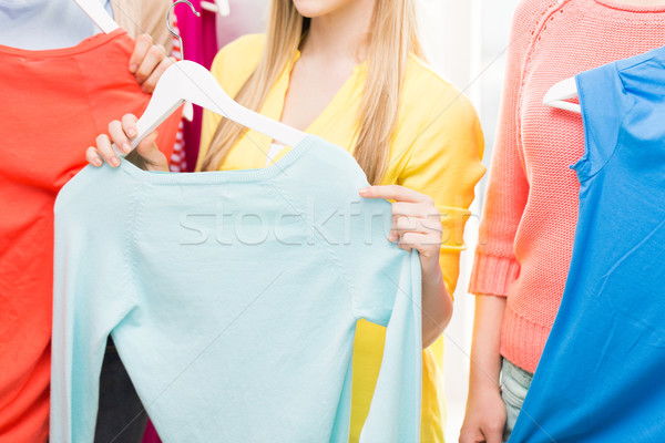 close up of happy woman holding hanger with shirt Stock photo © dolgachov