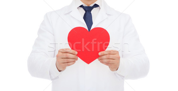 male doctor with red heart Stock photo © dolgachov