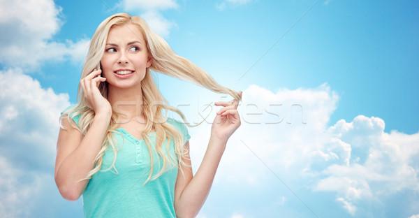 улыбаясь призыв смартфон Выражения Сток-фото © dolgachov