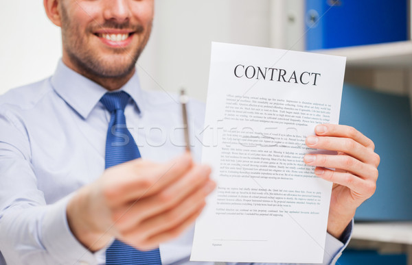 close up of businessman holding contract document Stock photo © dolgachov