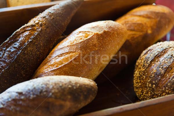 close up of bread loafs at bakery Stock photo © dolgachov