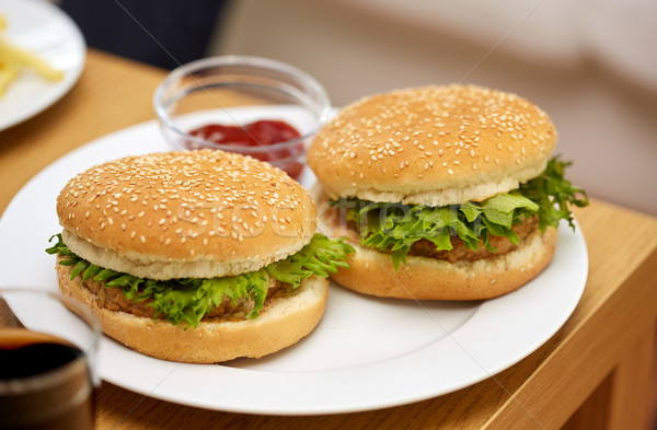 Twee tabel fast food ongezond eten Stockfoto © dolgachov